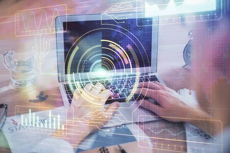 Businessman with computer background with technology theme hologram. Concept of big data. Double exposure. Banque d'images - 129473376