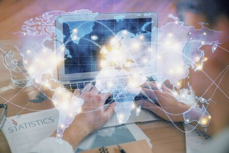 Multi exposure of businessman working on laptop on background. International business hologram in front. Concept of success.