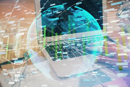 Multi exposure of businessman working on laptop on background. International business hologram in front. Concept of success. Banque d'images - 129473457