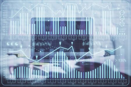 Multi exposure of forex graph and work space with computer. Concept of international online trading. Stock fotó