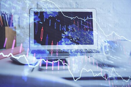 Forex market chart hologram and personal computer background. Double exposure. Concept of investment. Stock fotó