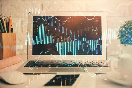 Forex market graph hologram and personal computer on background. Double exposure. Concept of investment. Stock fotó
