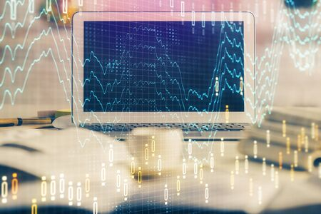 Financial market graph hologram and personal computer on background. Double exposure. Concept of forex.