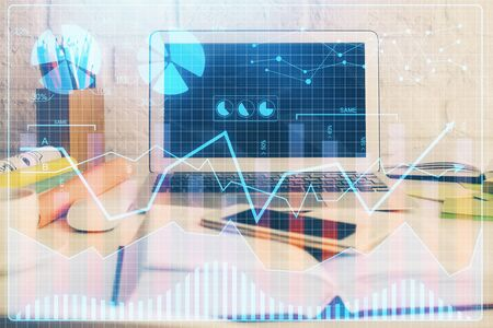 Financial market graph hologram and personal computer on background. Multi exposure. Concept of forex.