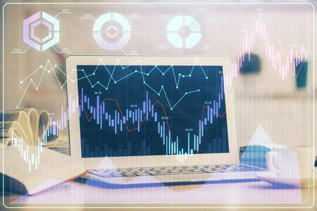 Stock market graph and table with computer background. Multi exposure. Concept of financial analysis. Stock fotó