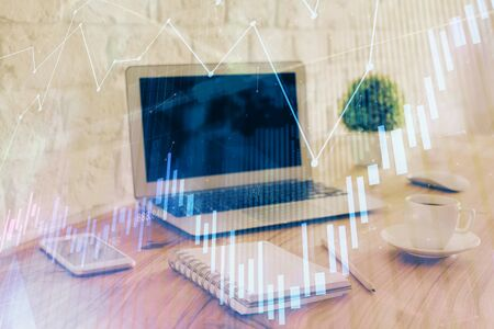Stock market chart hologram drawn on personal computer background. Double exposure. Concept of investment.