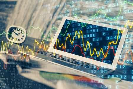 Double exposure of graph and financial info and work space with computer background. Concept of international online trading.