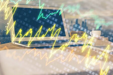 Forex market chart hologram and personal computer background. Double exposure. Concept of investment. Banco de Imagens