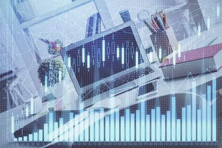 Double exposure of graph and financial info and work space with computer background. Concept of international online trading. Stok Fotoğraf - 129828734