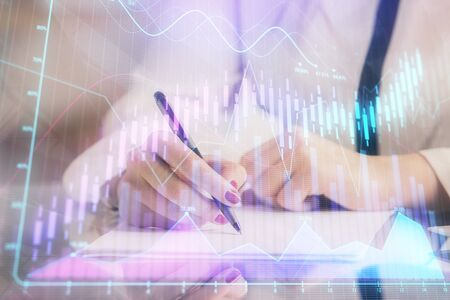 Double exposure of hands making notes with forex chart huds. Stock market concept. Stock fotó
