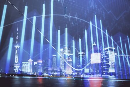 Financial graph on night city scape with tall buildings background double exposure. Analysis concept. 스톡 콘텐츠