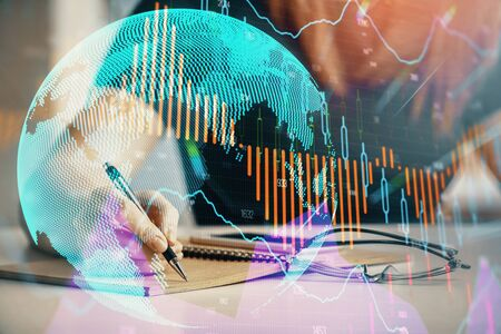 Multi exposure of womans hands making notes with forex graph hologram. Concept of technical analysis. Stock fotó