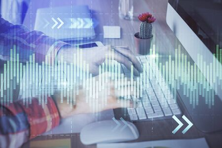 Double exposure of stock market chart with man working on computer on background. Concept of financial analysis.
