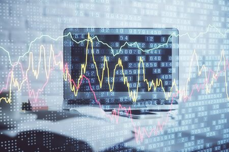 Forex market chart hologram and personal computer background. Double exposure. Concept of investment. Zdjęcie Seryjne
