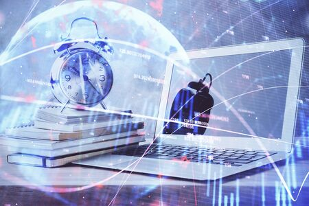 Financial chart drawing and table with computer on background. Multi exposure. Concept of international markets. Zdjęcie Seryjne