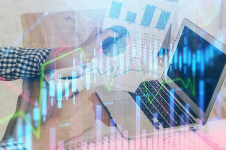 Double exposure of mans hands writing notes of stock market with forex graph background. Concept of research and trading. Stok Fotoğraf