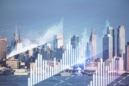 Forex graph on city view with skyscrapers background double exposure. Financial analysis concept. 스톡 콘텐츠