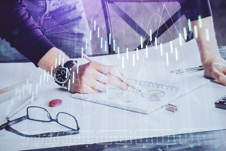 Financial trading chart double exposure with man desktop background.