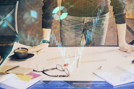 Multi exposure of man standing and planing investment with stock market forex chart. 写真素材