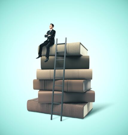 Businessman in suit sitting on stack of books with ladder. Business education concept