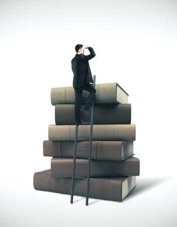 Businessman in suit standing on ladder on stack of books. Business education concept Stock Photo