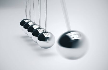 Newtons cradle, particularly of the spheres on white bacground. 3D Rendering Фото со стока