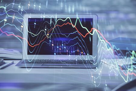 Forex market graph hologram and personal computer on background. Double exposure. Concept of investment. Zdjęcie Seryjne