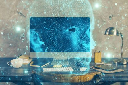 Double exposure of table with computer and brain hologram. Data innovation concept. 写真素材