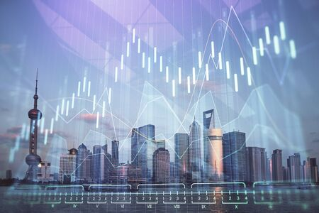 Forex graph on city view with skyscrapers background double exposure. Financial analysis concept. Stock fotó