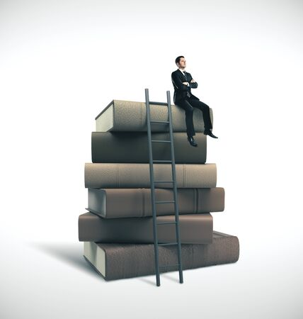Young businessman in suit sitting on stack of books with ladder. Business education concept