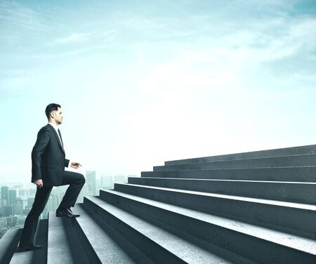 Businessman in suit walking near ladder in sky. Business challenge concept Stock Photo