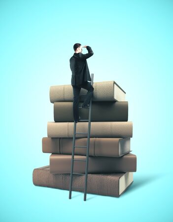 Businessman standing on ladder on stack of books. Business education concept