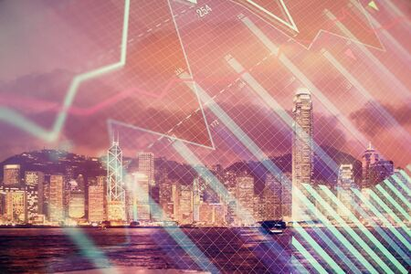 Multi exposure of forex chart drawings over cityscape background. Concept of success.