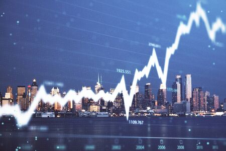Financial graph on night city scape with tall buildings background double exposure. Analysis concept. Stock Photo