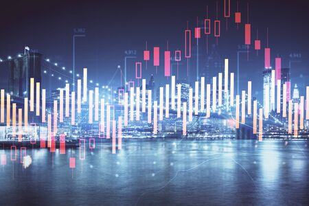 Financial graph on night city scape with tall buildings background multi exposure. Analysis concept. Stock Photo