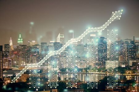 Double exposure of forex chart drawings over cityscape background. Concept of success. Banco de Imagens