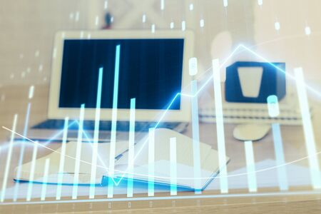 Forex Chart hologram on table with computer background. Multi exposure. Concept of financial markets. 写真素材