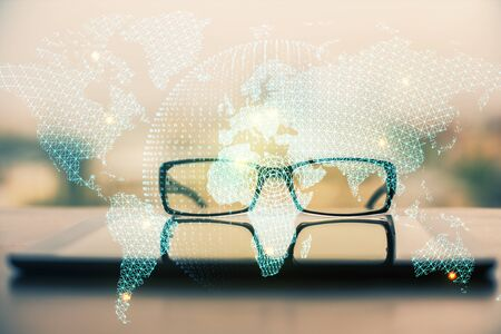 Business theme hologram with glasses on the table background. Concept of search. Double exposure.