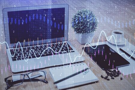 Double exposure of forex chart and work space with computer. Concept of international online trading. 版權商用圖片