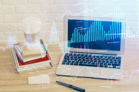 Financial chart drawing and table with computer on background. Multi exposure. Concept of international markets. Stock Photo