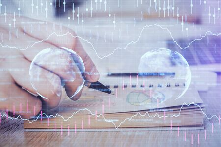 Multi exposure closeup hands with stock market forex graph. Stok Fotoğraf - 131957422