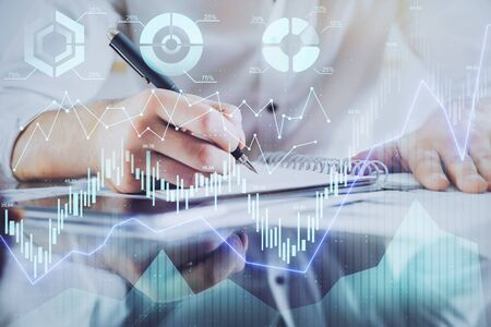Multi exposure of man planing investment with stock market forex chart. Banque d'images - 131957321