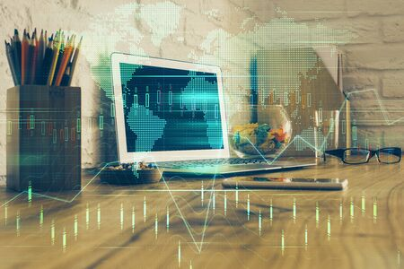 Double exposure of forex graph and work space with computer. Concept of international online trading. Фото со стока