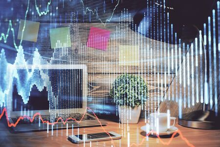 Multi exposure of forex graph and work space with computer. Concept of international online trading. Фото со стока