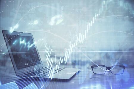 Forex Chart hologram on table with computer background. Multi exposure. Concept of financial markets. Фото со стока