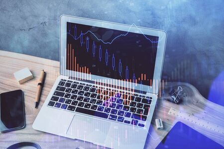 Multi exposure of graph and financial info and work space with computer background. Concept of international online trading. Фото со стока