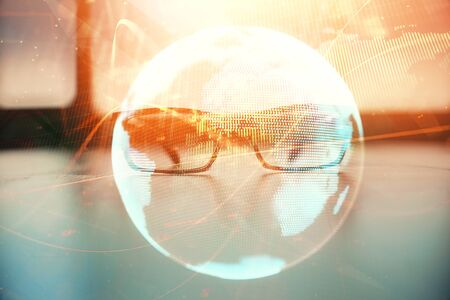 Business theme hologram with glasses on the table background. Concept of search. Double exposure. Imagens
