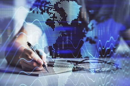 Multi exposure of womans hands making notes with forex graph hologram. Concept of technical analysis. Фото со стока