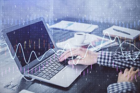 Double exposure of forex chart with man working on computer on background. Concept of market analysis.