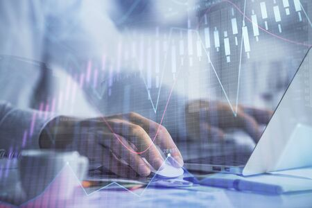Double exposure of forex graph with man working on computer on background. Concept of market analysis. 写真素材
